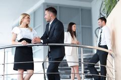Employees communicate standing on the terrace of the office. Royalty Free Stock Photo