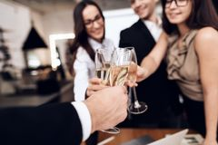 Employees of the company drink alcoholic beverages after a business meeting. royalty free stock images