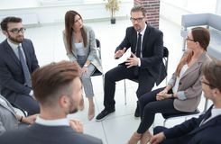 Employees of the company sitting in a circle and discussing work problems. Photo with text space royalty free stock photos