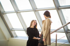 Employees of the company talk in the spacious hall of the office Stock Images