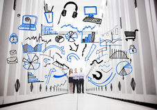 Employees in a data center standing in front of drawings. Of charts and computer sketches Royalty Free Stock Image