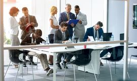Employees discus about business stock image