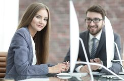 Employees discuss work issues in the office. Employees discuss work issues in a modern office Stock Photos
