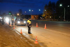 Employees dorozhno-patrol service conduct night RAID on the road. Royalty Free Stock Image