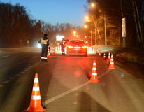 Employees dorozhno-patrol service conduct night RAID on the road. Royalty Free Stock Photo