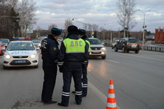 Employees dorozhno-patrol service controlled movement. Stock Photos