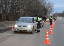 Employees dorozhno-patrol service controlled movement. Royalty Free Stock Photos