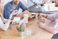 Employees eating lunch. Caucasian employees eating a healthy lunch while enjoying their break royalty free stock photos
