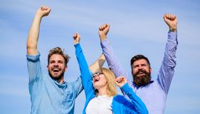 Employees enjoy feeling of freedom. Freedom concept. Company happy colleagues office workers enjoy freedom friday. Evening, sky background. Men with beard in royalty free stock image