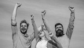 Employees enjoy feeling of freedom. Freedom concept. Company happy colleagues office workers enjoy freedom friday. Evening, sky background. Men with beard in stock photo