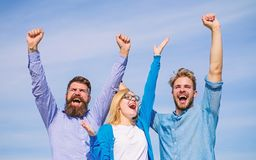 Employees enjoy feeling of freedom. Men with beard in formal wear and girl finished working week. Company happy. Colleagues office workers enjoy freedom friday stock photo