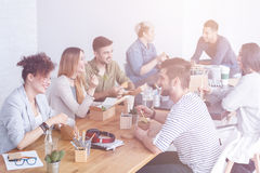 Employees enjoying lunch. Employees enjoying their lunch and talking to each other royalty free stock image