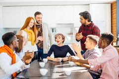 Employees enjoying spending time togeter while drinking coffee royalty free stock images