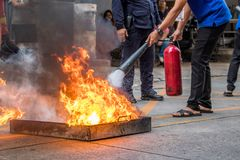 Employees firefighting training,Extinguish a fire.  stock photos
