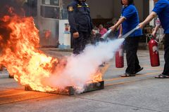 Employees firefighting training,Extinguish a fire.  royalty free stock image