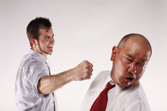 Employees fist  fighting Royalty Free Stock Photo