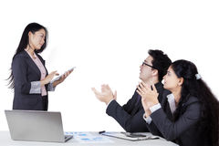 Employees giving applause to their leader. Portrait of two businesspeople giving applause to their leader after business presentation stock photos