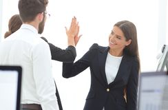 Employees giving each other high five. The concept of teamwork royalty free stock images