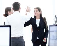 Employees giving each other high five. royalty free stock photo