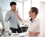 Employees giving each other a high five. The concept of successful work royalty free stock photos