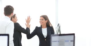 Employees giving each other high five. The concept of teamwork stock photo