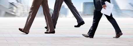 Employees going against the office. Panorama. Royalty Free Stock Photography