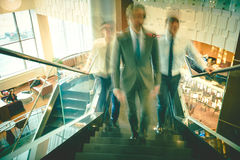 Employees going upstairs Stock Photo
