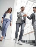 Employees greet each other in the office building. In full growth.employees greet each other in the office building.photo with copy space royalty free stock photo