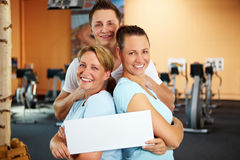 Employees in gym holding Stock Image