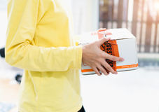 Employees hold parcel damaged before delivery to customer. The company is responsible for replacing it. Royalty Free Stock Photography