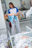 Employees holding clean clothes Stock Images