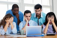 Employees of an insolvent startup company. At office stock image