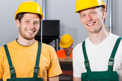 Employees during job in factory. Employees during job in a factory, horizontal royalty free stock photos