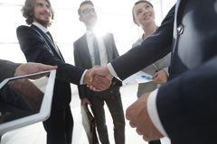 Employees look at the handshake business partners Stock Photography