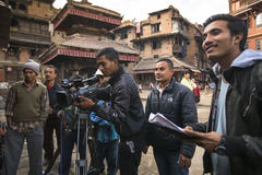 Employees Nepali TV shoot a report about potters from Bhaktapur Stock Photos