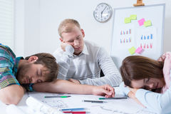 Employees after night at work. Employees sleeping after night at work, horizontal Royalty Free Stock Image