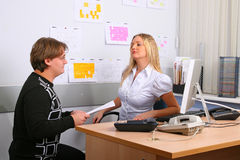 Employees of office. Two young employees of office in an operating time Stock Photo