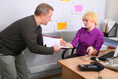 Employees of office. Two employees of office in an operating time Royalty Free Stock Images
