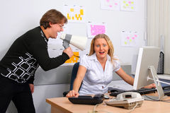 Employees of office. Boss shouts in a megaphone at employee of office Stock Photo