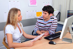 Employees of office. Young woman passes interview with chief of office Stock Photo