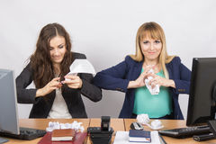 Employees of the office crumple paper with an evil expression individual Stock Photo