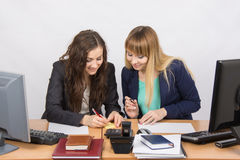 Employees of the office fun writing something on paper for notes Stock Images