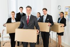 Employees in office holding cardboard boxes Stock Photography