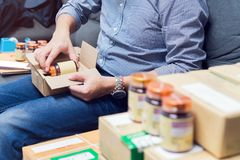 Employees are packing a parcel in the send to the customer. Royalty Free Stock Photo