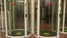 Employees pass through the entrance of the secret enterprise. The security system at the entrance stock video footage