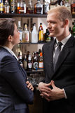 Employees in a pub after work Royalty Free Stock Photo