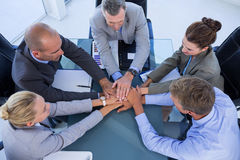 Employees putting hands together Stock Photos