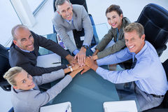 Employees putting hands together Royalty Free Stock Photos