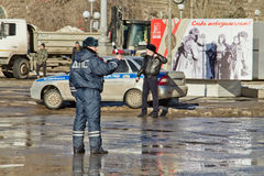 Employees of road patrol police regulate traffic at the busy int. VOLGOGRAD - JANUARY 30: Employees of road patrol police regulate traffic at the busy Royalty Free Stock Images