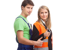 Employees showing the OK gesture. Physical worker and office worker showing the OK gesture Stock Photo